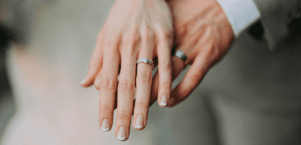 man and woman showing wedding rings